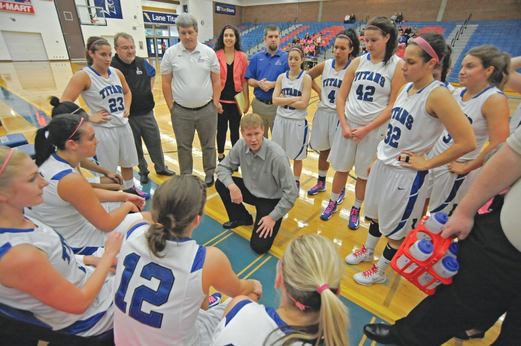 The Titan women circle around head coach Greg Sheley. Photo credit: LCC Torch