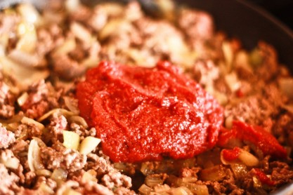 5. Add one 1-1/2 cup of tomato paste.