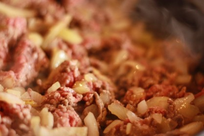 4. Add ground beef and cook until brown. Be careful not to overcook the beef; you will be baking it later.