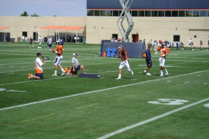 Tim Tebow throws a pass during training camp in 2010, his rookie season. (David Saez/EDN)