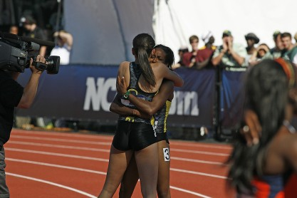 Oregon track stars embrace in a hug (Gary Breedlove/Eugene Daily News)