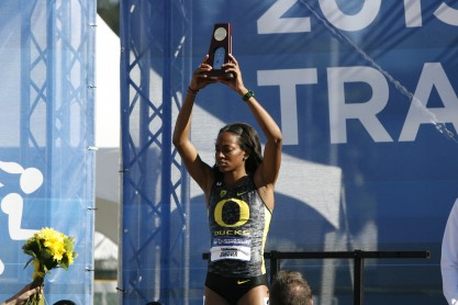 Oregon's English Gardner holds up her championship trophy (Gary Breedlove/Eugene Daily News)