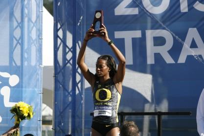 Oregon's English Gardner holds up her championship trophy (Gary Breedlove/Eugene Daily News)
