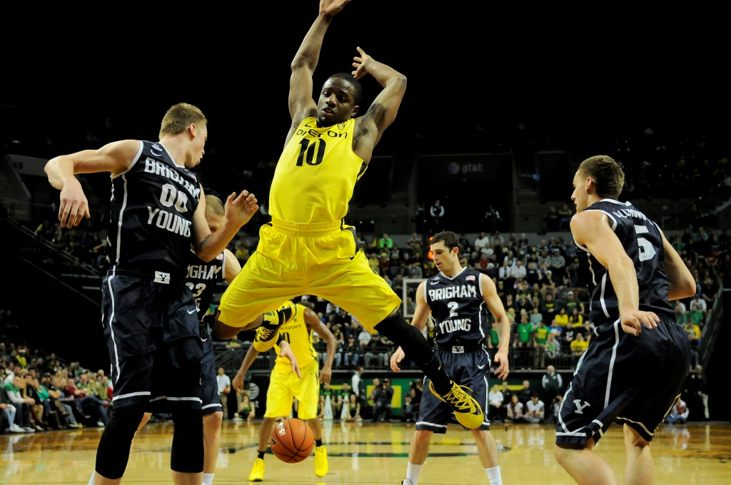 Johnathan Loyd goes airborne in Oregon's first matchup against BYU. Photo - Craig Strobeck/Fishduck.com
