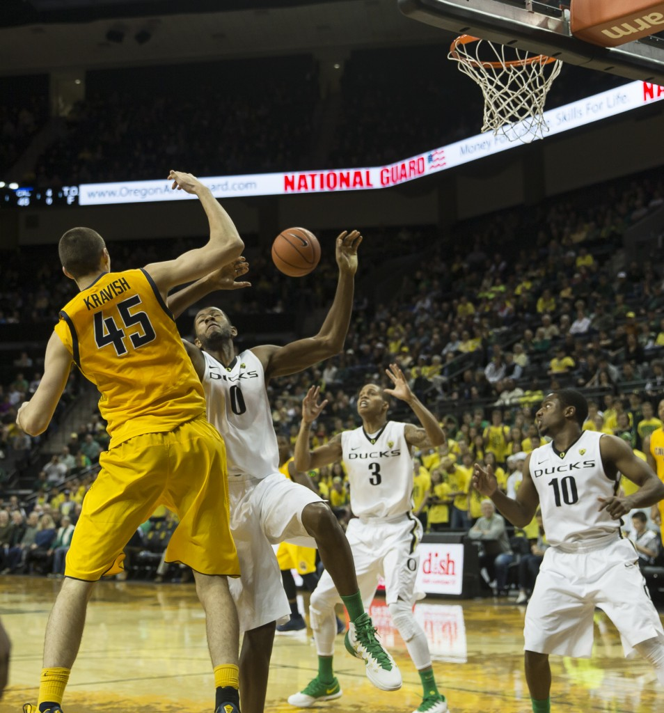 Mike Moser having the ball swatted away Photo - Dave Peaks