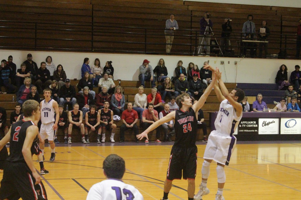 PG Mason Green-Richards shoots contested jumper over G/F Carson Cook. Photo by Corey Buchanan