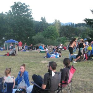 Crowd Listening To Bands At Dexter Lake | Photo by Tim Chuey