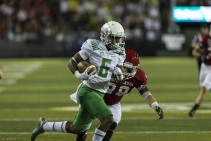 Oregon Wide Receiver Darren Carrington on a 50 yard Punt Return for a Touchdown.  Photo - Dave Peaks