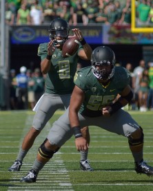 Oregon's Marcus Mariota takes the snap.   Photo by Eugene Johnson / for the Eugene Daily News