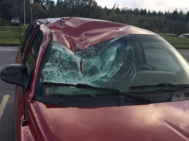 Durango Damage Done When Wind Lifted Up Flipped Car Into It | Photo by KVAL TV