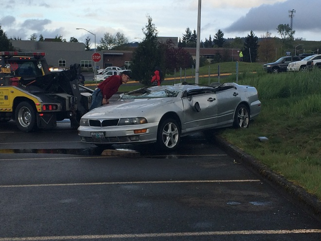 Flipped Car Placed Upright | Photo by KVAL TV