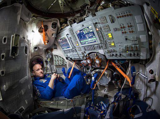 US Astronaut In Soyuz Simulator| Photo by  NASA
