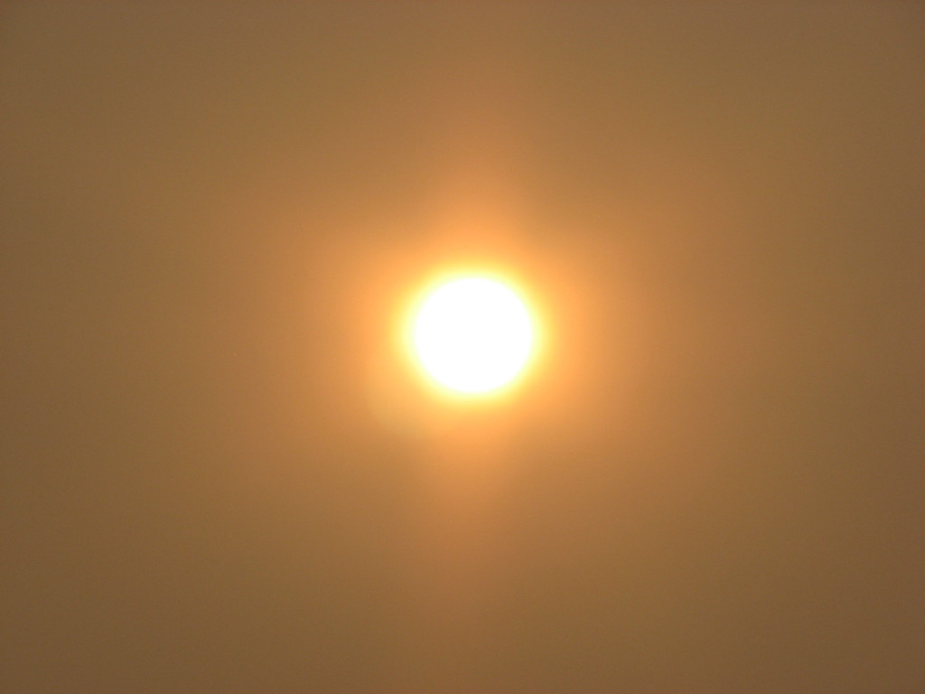 Sun Through Smoke Over South Eugene | Photo by Tim Chuey